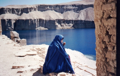 A hazara woman sits by the solace by the shrine of Ali Band-i-Amir