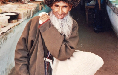 An aksakal greybeard stops for the camera in Konye Urgench bazaar Turkmenistan