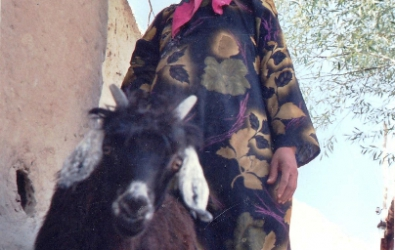Yaghnobi woman with a goat