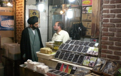A mullah and date seller in a Shiraz bazaar